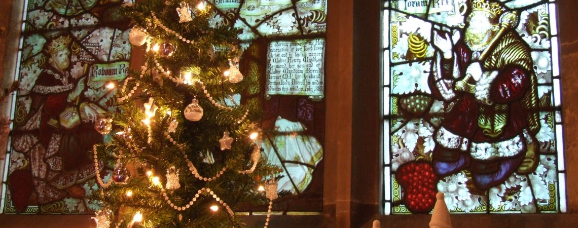 Holy Trinity Church and decorated Christmas Trees